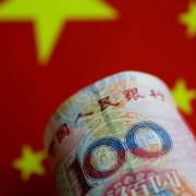 Chứng khoán châu Á chạm đáy khi đồng nhân dân tệ trượt giá