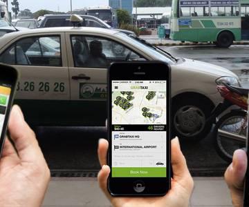 Taxi và Grab tranh cãi về quy định gắn mào trên nóc