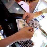 Giá vàng, USD giảm sau tin Fed tăng lãi suất