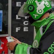 Grab và Gojek sáp nhập, nguy cơ hiện hữu đối với nền kinh tế số